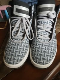 pair of white-and-black Nike running shoes Calgary, T1X