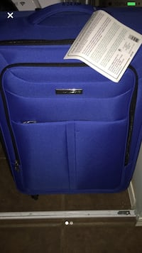 Blue medium suitcase. New and tags still attached. Willing to negotiate price Edmonton, T6J 5S8