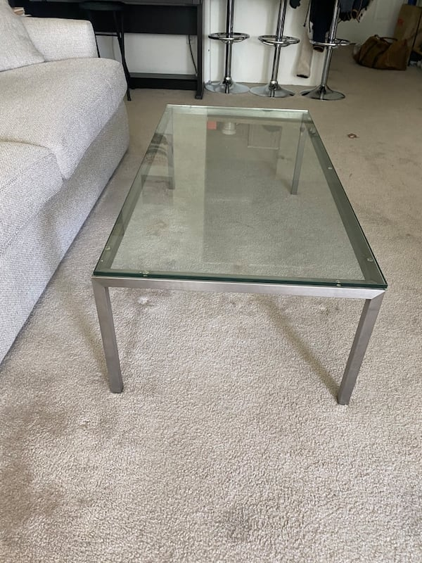 Glass coffee table with metal / stainless steel base 4292294b-396e-403c-93d9-d91603ab96d6