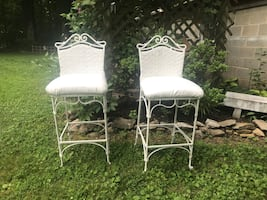 Two cast iron barstools/chairs