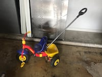 Yellow, blue, and red push trike with safety buckle! Gilbert, 85234