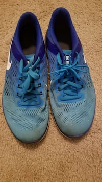 Pair of blue-and-white Nike running shoes Jacksonville, 28546