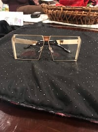 Big gold glasses frames I bought from New York they are too big for my face or best offer