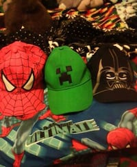 several assorted color and character baseball caps