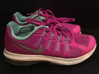 Pair of pink-and-white nike running shoes Vancouver, V6E 1A6