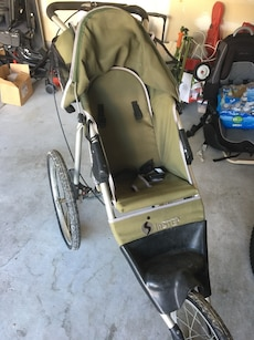 baby's black, gray and green jogging stroller