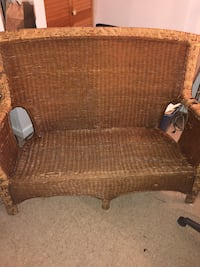 brown wicker framed brown padded armchair Bear