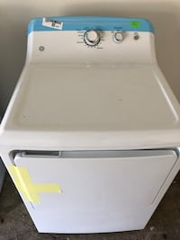 White front-load clothes washer Houston, 77042