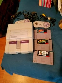 white Nintendo 64 console with controller and game cartridges Milwaukee, 53204
