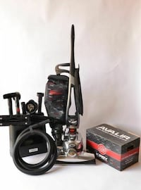 black and gray Kirby Avalir upright vacuum cleaner