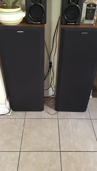 Two black-and-brown sony tower speakers