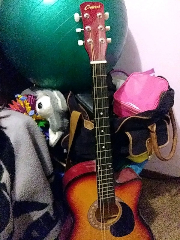 black and brown acoustic cresent guitar