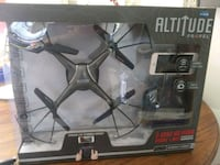 black quadcopter drone with box