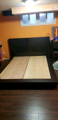 black wooden bed frame and white mattress 549 km
