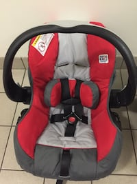 Baby's red and gray car seat carrier with base