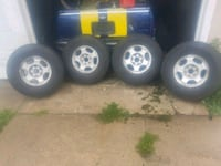 four gray 5-spoke car wheels with tires null