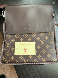 brown and black Louis Vuitton leather crossbody bag 1292 mi