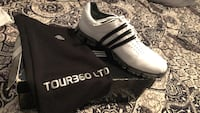 pair of black-and-white Adidas cleats 1818 mi