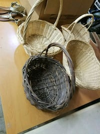 two brown wicker baskets with white plastic baskets Webster, 77598