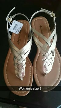 pair of white-and-brown leather sandals Lexington, 40515