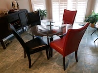 BEST OFFER!! Gets this new looking glass table/w wood base & 4 Chairs! Caledon, L7E 2J9