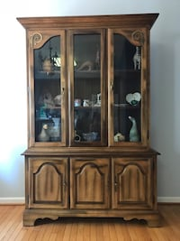 brown wooden framed glass display cabinet Boyds, 20841