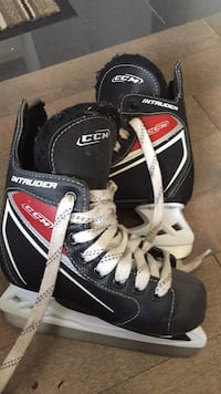Black-and-white bauer inline skates size 13 Toronto, M6M 3N9