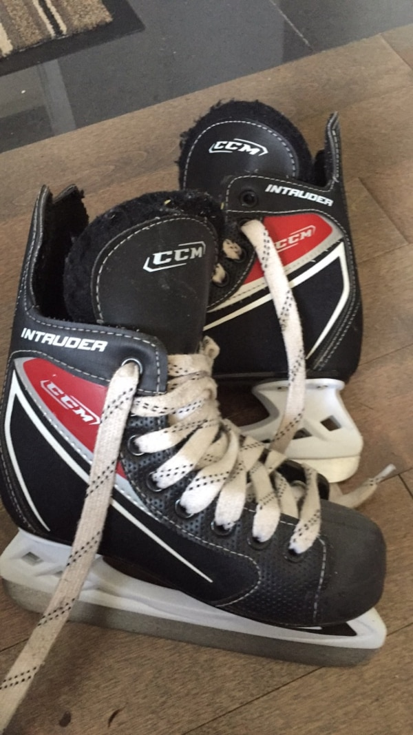 Black-and-white bauer inline skates size 13