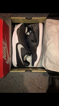 pair of black-and-white Nike basketball shoes Kissimmee, 34744