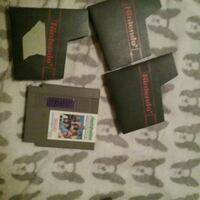 two assorted game cartridges with box Macon, 31211