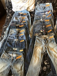 two blue and one black denim jeans Las Vegas, 89130