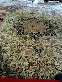 brown, green, and white floral area rug 7 km