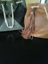 two black and brown leather bucket bags Baltimore, 21206
