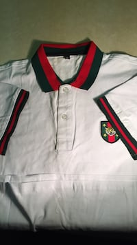 White, black, and red polo shirt