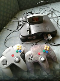black Nintendo 64 console with controllers Webster, 14580