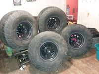 four black auto wheel with tires Galena, 66739