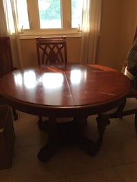 round brown wooden table with four chairs dining set Hamilton, L8N