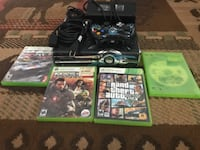 black Xbox 360 game console with game cases NORTHHIGHLANDS
