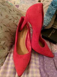pair of red suede pointed-toe pumps New York, 10027