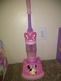 purple and pink Minnie Mouse upright vacuum cleaner toy