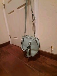 New purse. 2 tassles. View photos. $20 Cedar Crest