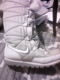 pair of white Nike Air Force 1 high shoes 255 mi