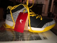 pair of black-and-yellow Nike basketball shoes SURREY