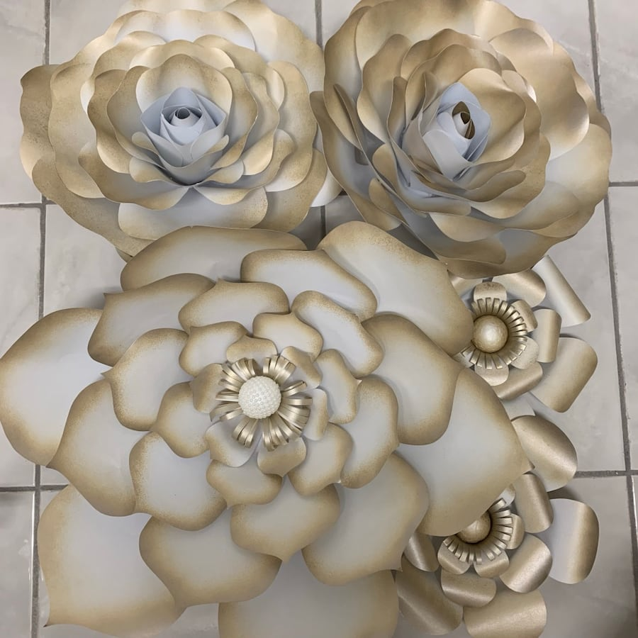 Gold and white paper flowers for decor, great for bridal showers