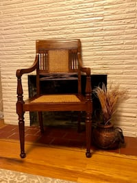 Antique wood and cane armchair
