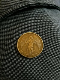 round gold-colored coin Columbus, 43223