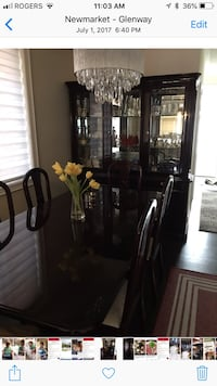 Black wooden framed glass display cabinet and table with 6 chairs Newmarket, L3X 0H4