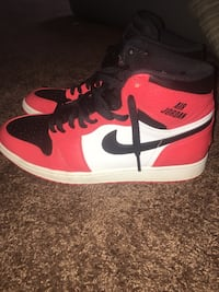 pair of white-and-red Air Jordan 1's Lithonia, 30038