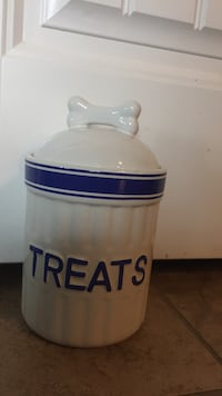 white and blue ceramic canister