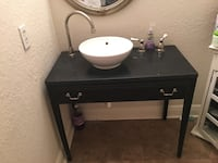 White porcelain sink bowl and Antique table with faucet and handles. Cutler Bay, 33189
